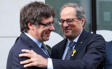 El 'Presidente de la República catalana' en el exilio, Carles Puigdemont, y el representante del Estado Español en Cataluña, Quim Torra.