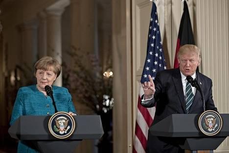 Trump y Merkel (Foto: Bloomberg)